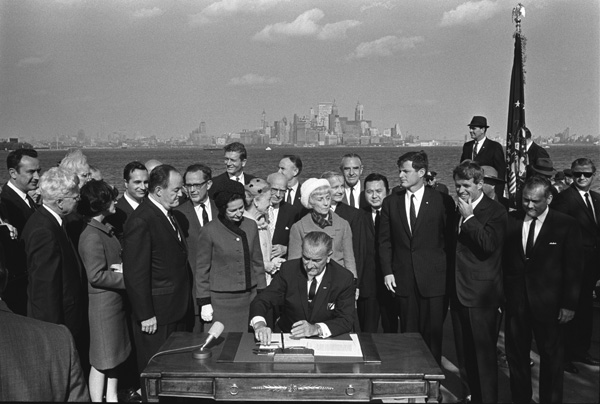 President Johnson signs the Immigration and Nationality Act of 1965. (NARA Identifier 2803428)